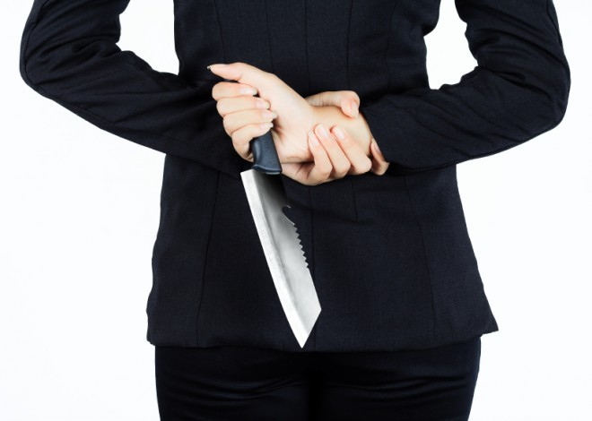 Back of business woman with aknife