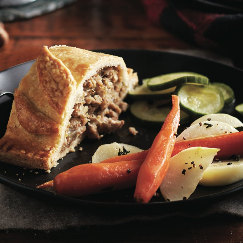 Tourtiere, pickled vegetables and buttered root vegetables