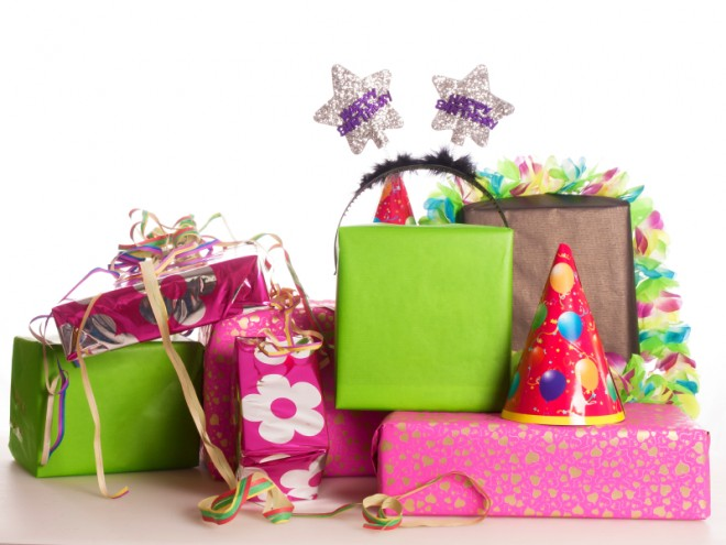 a stack of colorful birthday presents - Presents For Kids