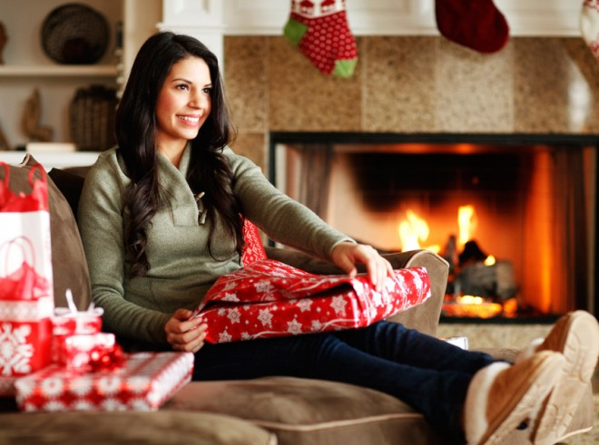 How to get glowing skin this holiday season, woman opening gifts