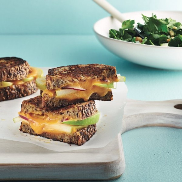 Gourmet grilled cheese sandwich with parsley salad