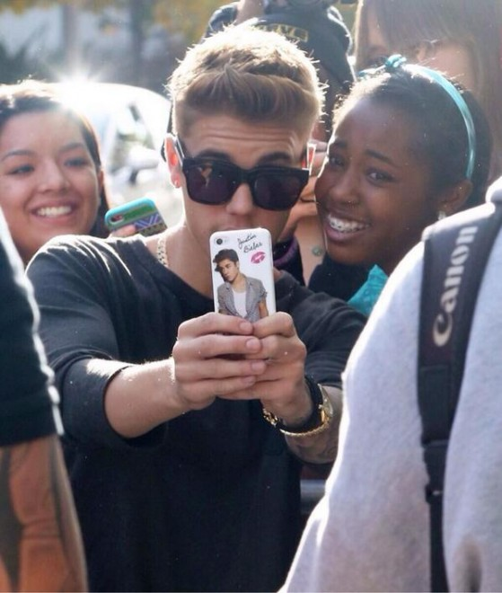 Justin Bieber with fan Dec 2013