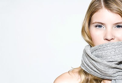 Cold girl wearing winter scarf