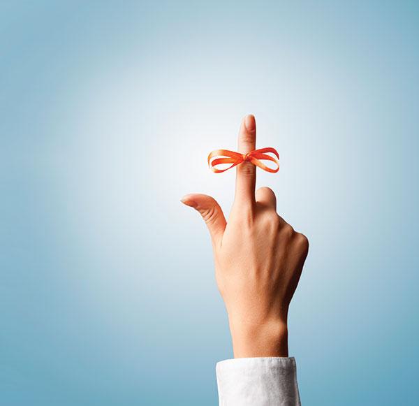 Orange-Ribbon-wrapped-around-finger-brain-health