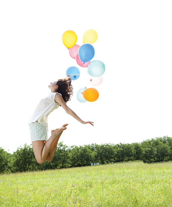 Woman-jumping-in-field-with-balloons-health-news