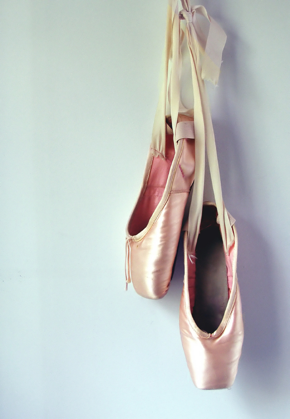 ballet shoes hanging on wall