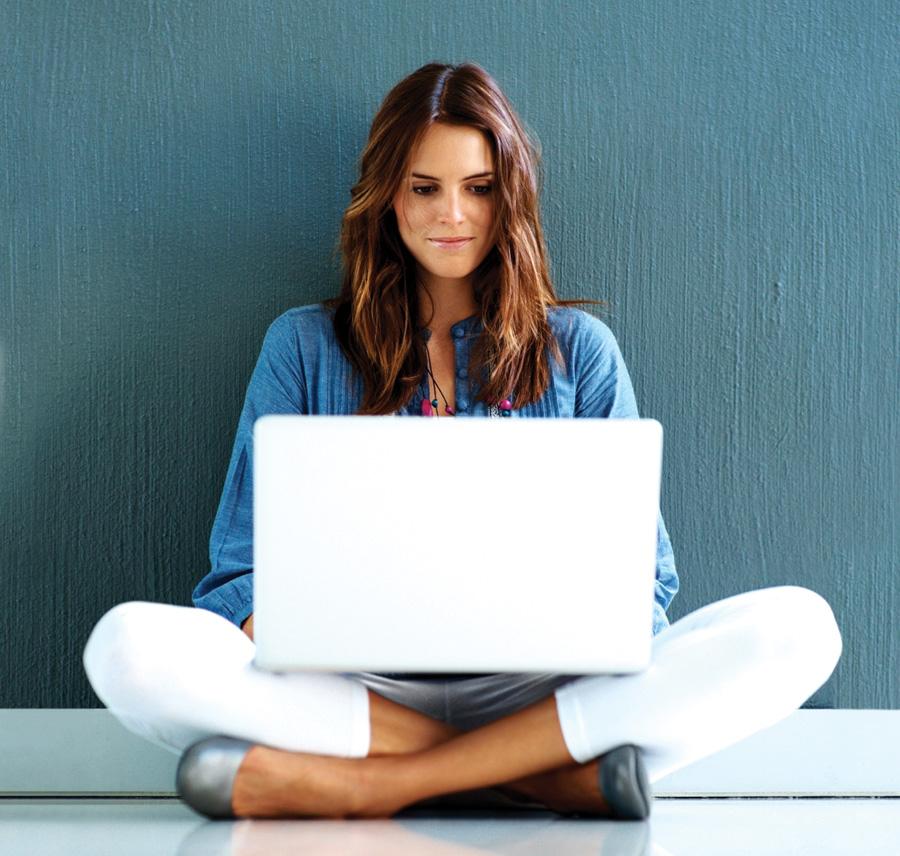 woman on laptop sitting on floor