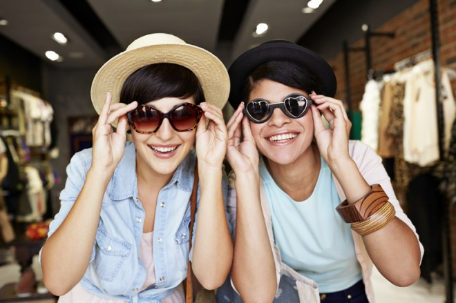 Women/friends Trying on Sunglasses