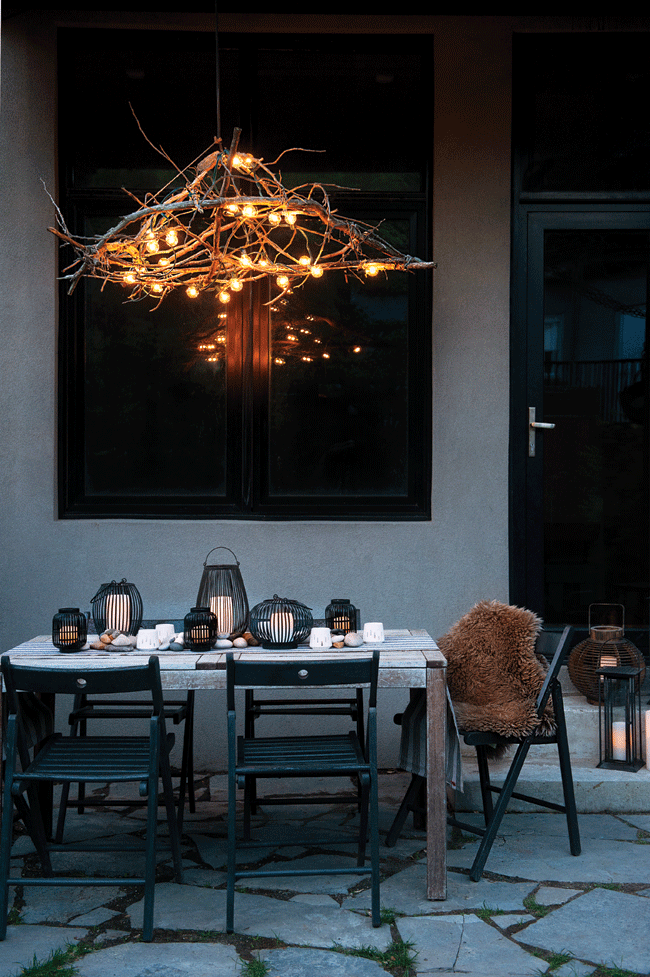 rustic-chandelier-tree-branches-backyard-outdoor-entertaining-evening-night-dining-dinner-party