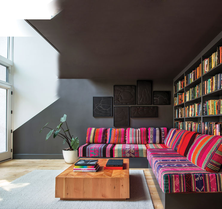 living-room-sofa-stripe-colourful-textile-black-walls