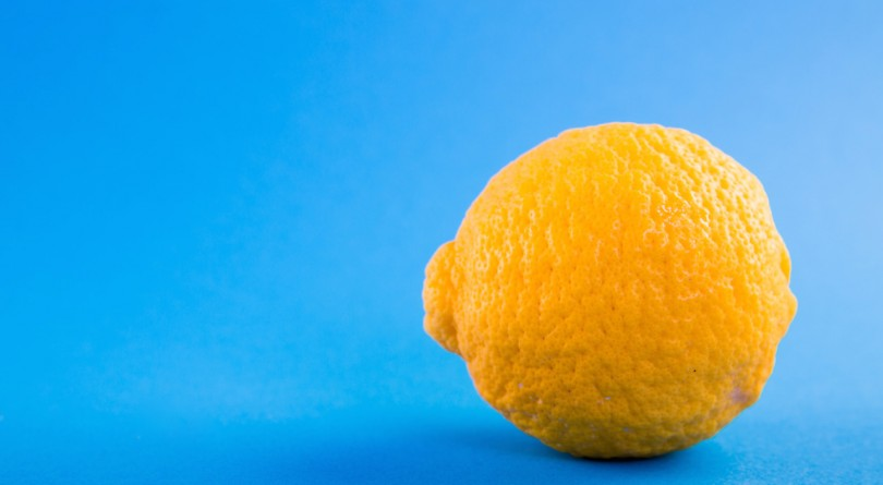 Image of a lemon on a blue background for flu fighting tea article