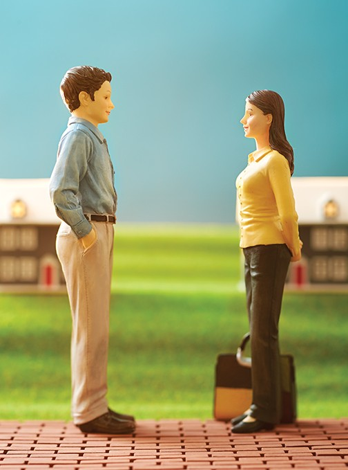 Parent toy miniature figurines standing with a briefcase, about to move and divorce
