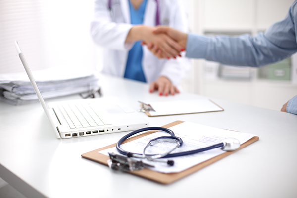 doctor and pharmacist shaking hands