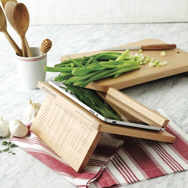 Cutting board, recipe holder and chopped vegetables