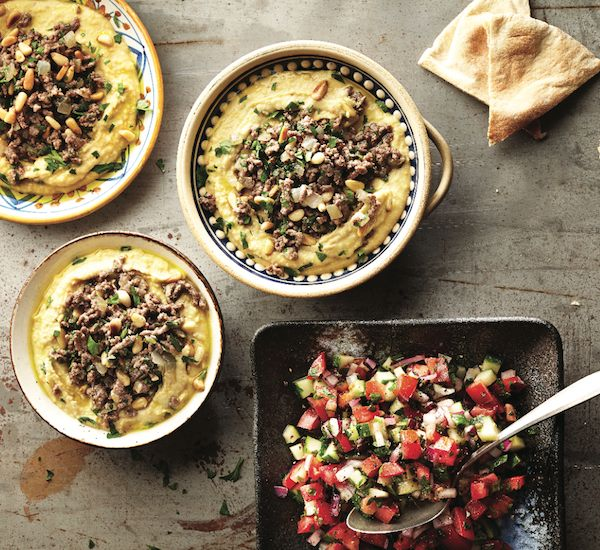 Creamy hummus, spiced lamb and chopped vegetable salad