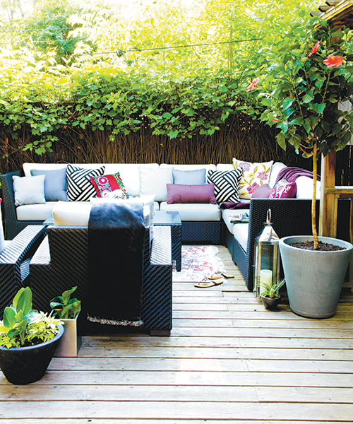 outdoor decorating tips-backyard oasis with couches and pillows