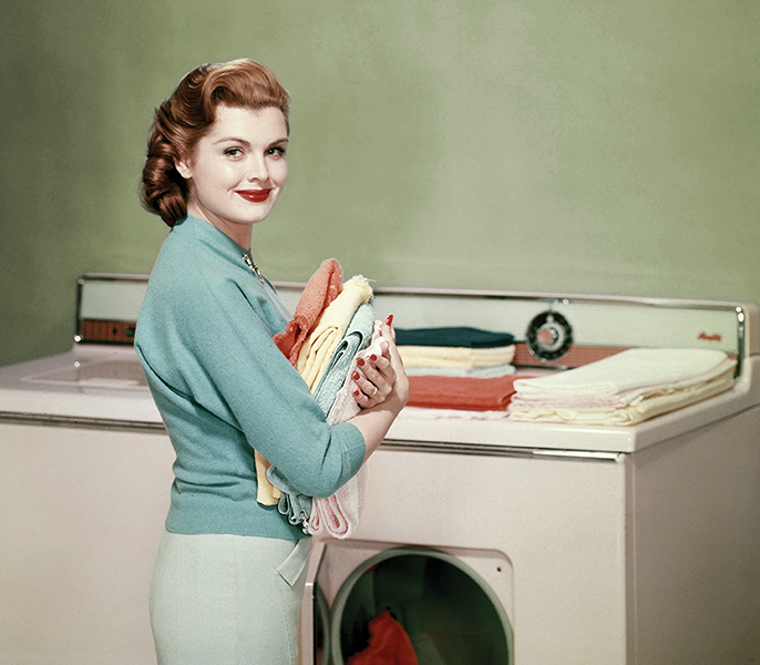 woman doing laundry, folding clothes