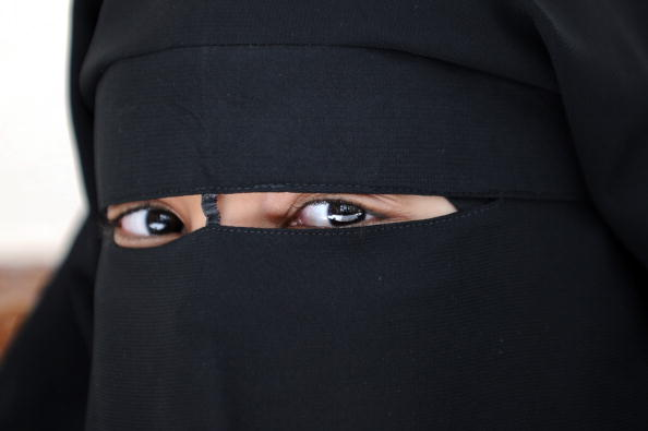 A Muslim woman wearing the niqab (veil which covers the body and leaves only a small strip for the eyes) poses during a meeting with Imam Ali El Moujahed on May 18, 2010 in Montreuil, outside Paris. The French parliament unanimously adopted on May 11, 2010 a resolution condemning the full-face Islamic veil as an affront to the nation's values. AFP PHOTO FRED DUFOUR (Photo, Fred Dufour/AFP/Getty Images)