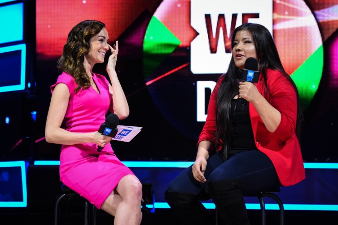 Rinelle Harper, right, speaks at Save the Children's WE Day with Amanda Lindhout.