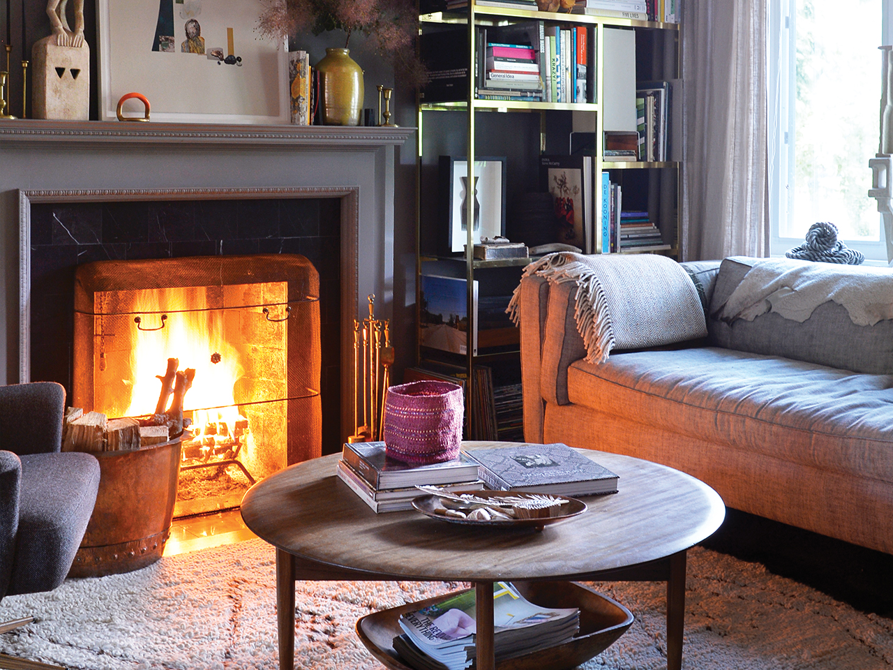 Picture of a cozy living room with a fire place for article on how to enjoy your home more