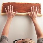 Rolling the cinnamon twist bread recipe's dough and sugar spread together