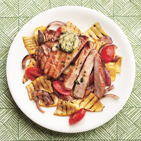 Grilled pork chops with basil butter and grilled vegetables