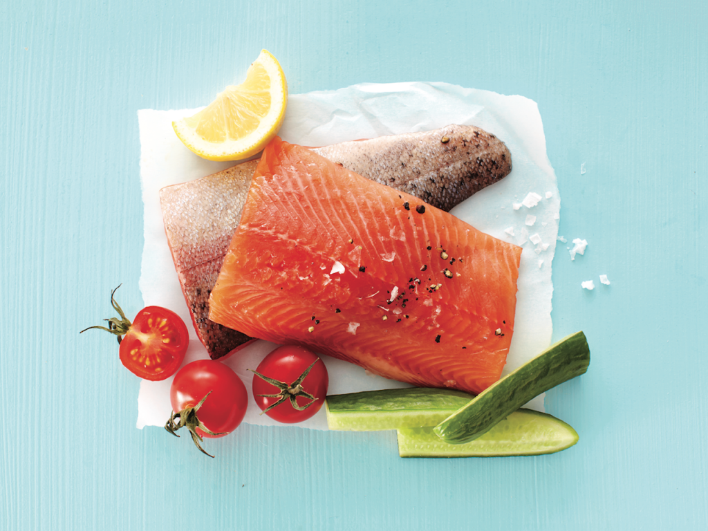 Freezer storage: Fresh piece of trout with cucumbers, tomatoes and lemon