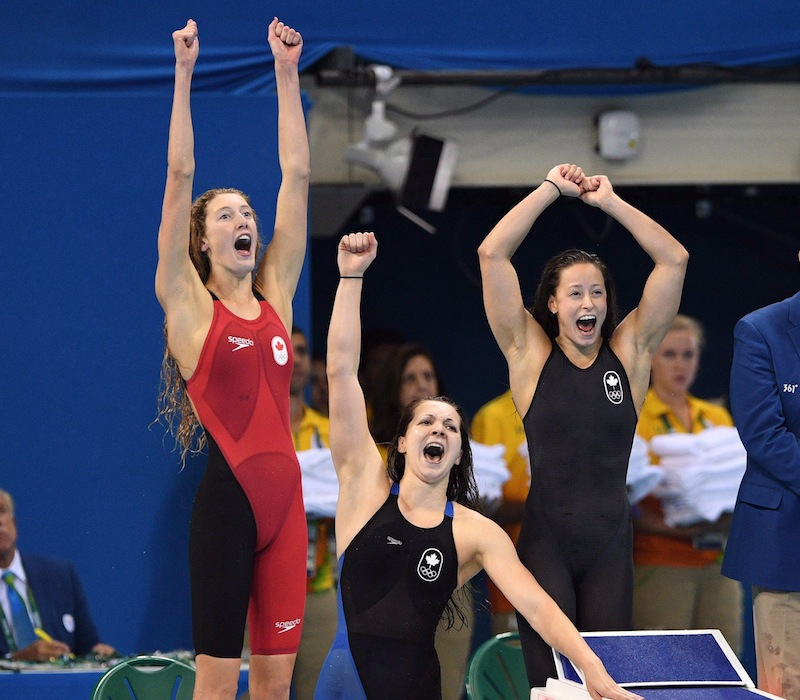 Canada's Taylor Ruck, left to right, Brittany MacLean, Katerine Savard and Penny Oleksiak take bronze in the women's 4 x 200m freestyle relay