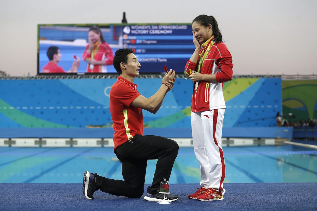 Olympic proposal: China's diver Qin Kai, left, proposes to silver medalist He Zi.
