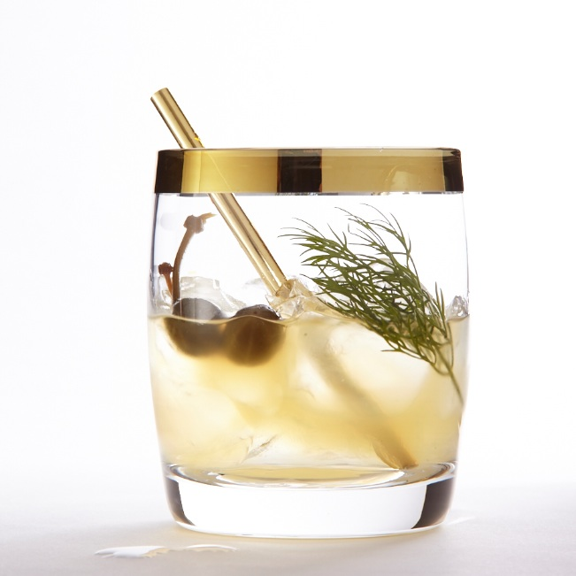 Savoury vodka cocktail with caper berries and dill