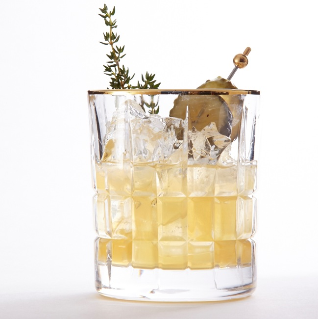 Savoury whiskey cocktail with tarragon and pickle