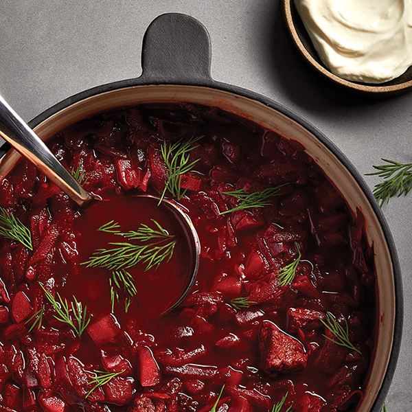 borscht with dill garnish