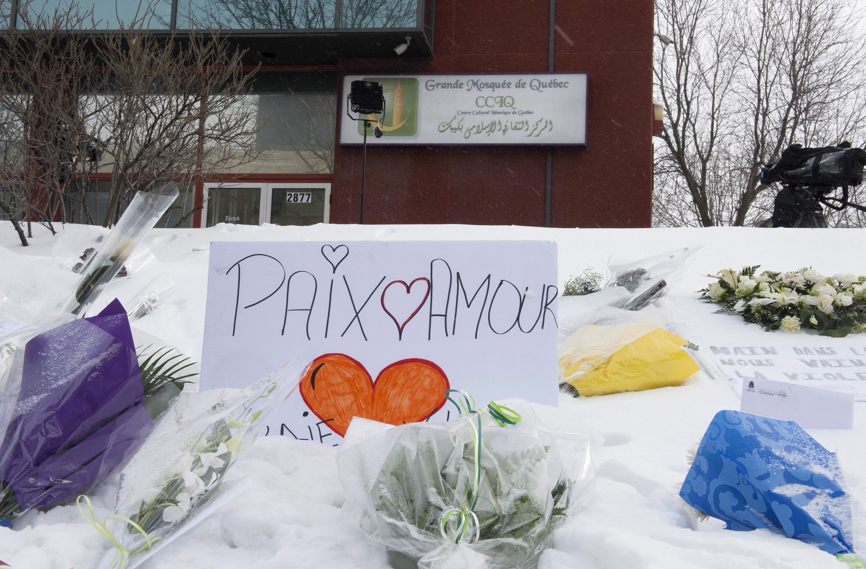 Signs sit outside the Grande mosquee de Quebec, Wednesday, February 1, 2017 in Quebec City. The mosque was the site of a deadly shooting which left six worshippers dead on Sunday, Jan. 29. THE CANADIAN PRESS/Jacques Boissinot