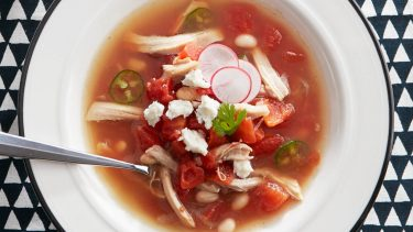 chicken posole with a can of beans, radishes and diced tomatoes