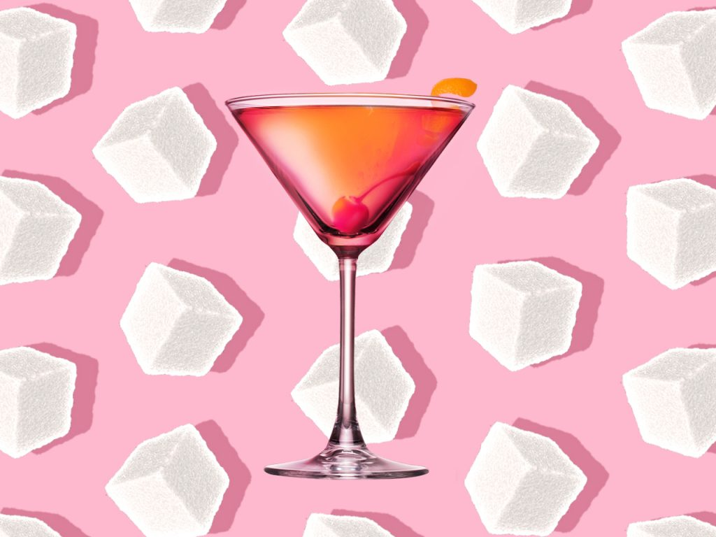 reduce sugar: a sugary martini sits on a background of sugar cubes