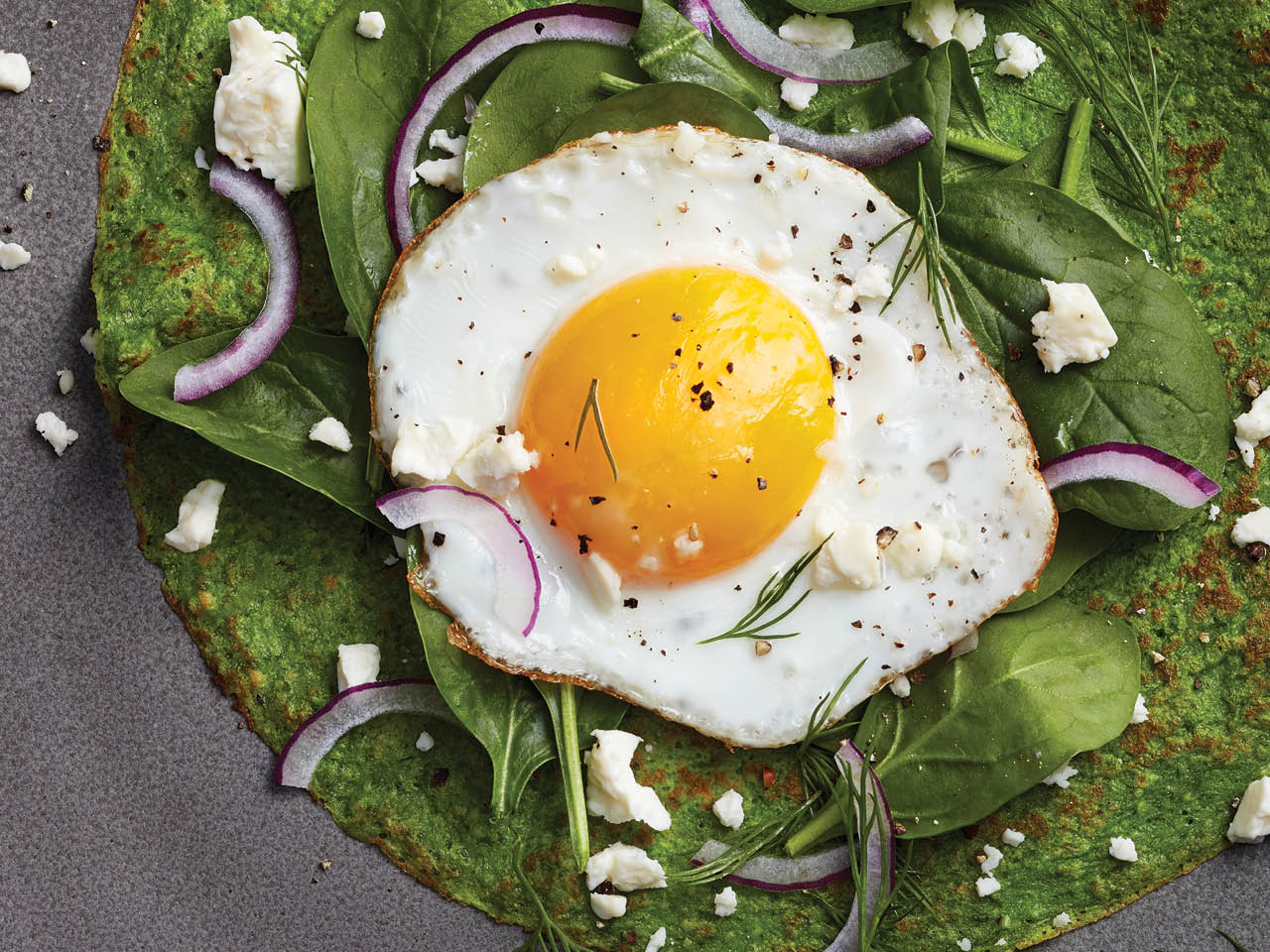 garden spinach crepes with and egg on top