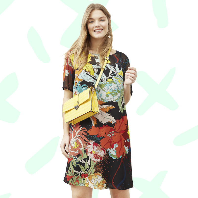 Super cute girl in mango floral dress with yellow purse