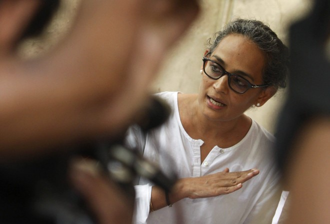 """FILE – In this July 7, 2010 file photo, Booker Prize-winning novelist Arundhati Roy speaks during a meeting protesting the killing of freelance journalist Hem Chand Pandey in a police encounter, in New Delhi, India. Roy has joined the growing number of writers, filmmakers, scientists and historians voicing alarm over what they describe as a climate of religious intolerance and violence in India. Roy, most famous for her 1997 novel """"The God of Small Things,"""" said in a sharply worded editorial Thursday, Nov. 5, 2015, in The Indian Express that millions of minorities """"are being forced to live in terror, unsure of when and from where the assault will come."""" (AP Photo/Mustafa Quraishi, File)"""