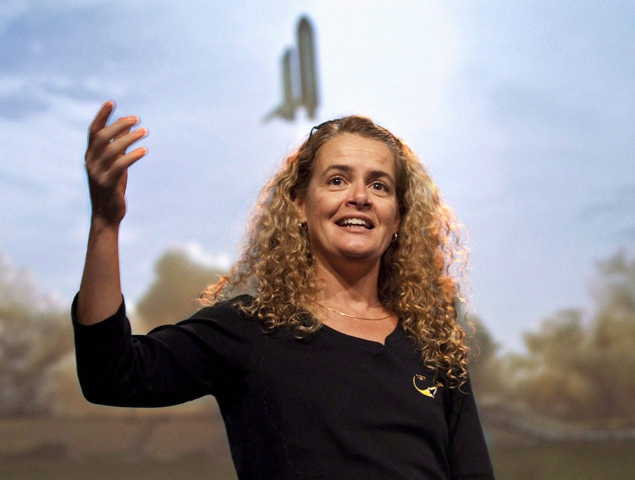 Canadian astronaut Julie Payette describes her mission to the International Space Station with a photograph in the background of the space shuttle with her in it during lift off on Friday August 28, 2009 in Longueuil, Que. The federal government is set to reveal Canada's next governor general Thursday with an announcement outside the doors of the Senate. Sources are telling The Canadian Press and others that astronaut Julie Payette is among the top contenders. THE CANADIAN PRESS/Paul Chiasson