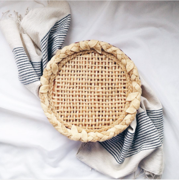 decorative pie crusts: braided pastry along border and woven lattice with thin stripes in centre
