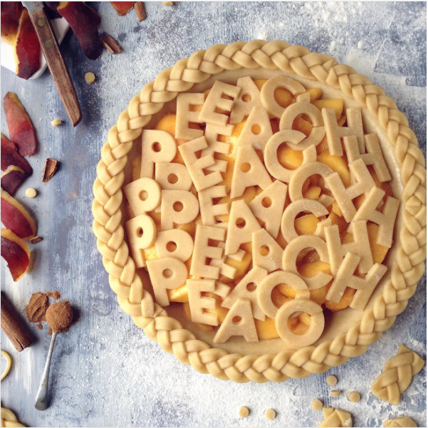 decorative pie crusts: peach pie with letter cut outs and braided edge