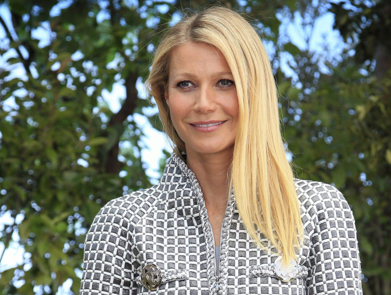 "Gwyneth Paltrow poses for photographers before Chanel's Spring-Summer 2016 Haute Couture fashion collection in Paris. Paltrow hosted the inaugural ""In Goop Health"" event Saturday, June 10, 2017, in Culver City, California, where about 600 women spent the day chatting, learning, eating, shopping and generally indulging in the designer-wellness lifestyle touted by goop.com. (AP Photo/Thibault Camus, File)"