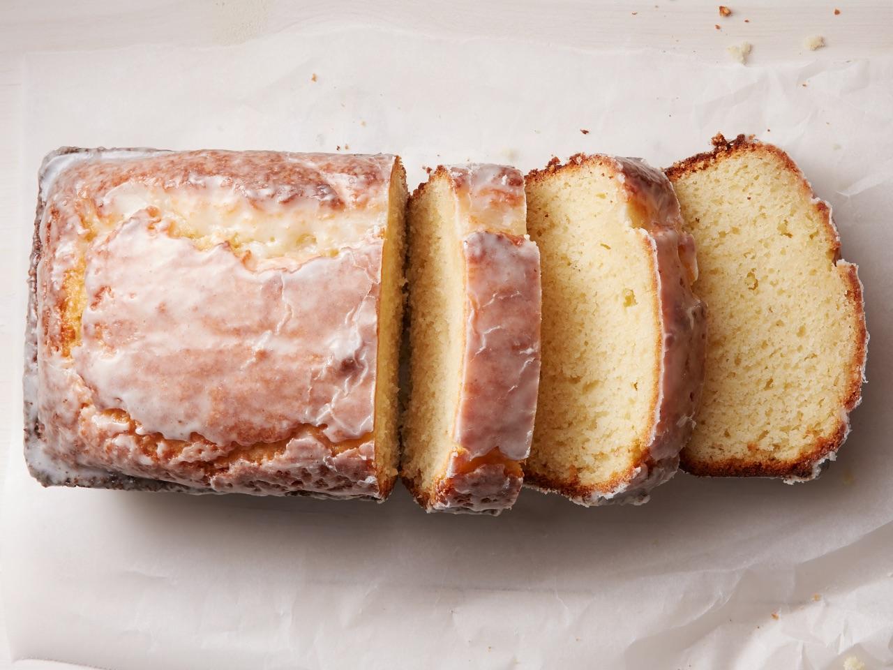 Glazed lemon loaf on parchment paper.