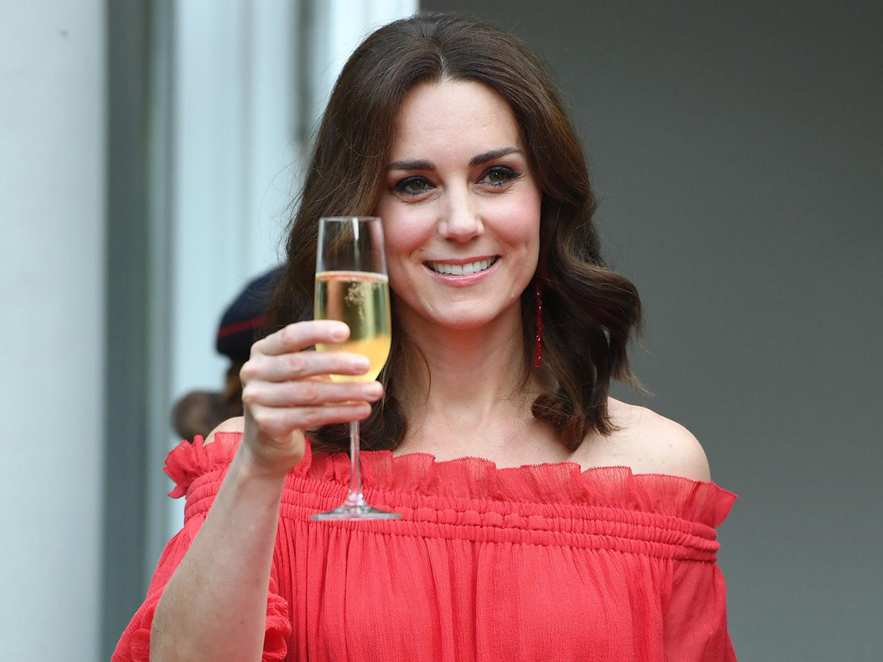 The Duchess makes a toast in Kate Middleton's red dress