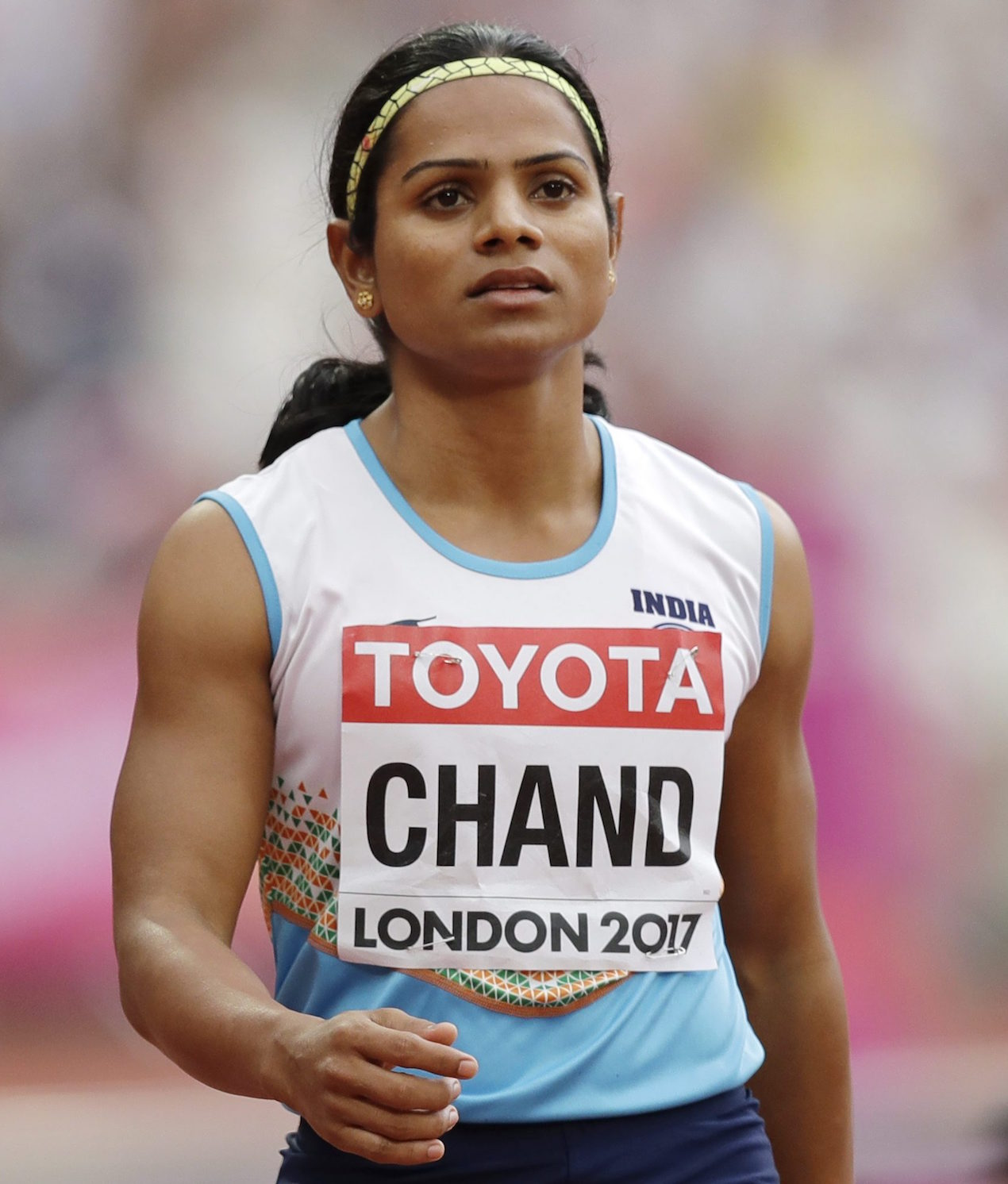 India's Dutee Chand checks her time after a women's 100m heat during the World Athletics Championships in London Saturday, Aug. 5, 2017. (AP Photo/Tim Ireland)