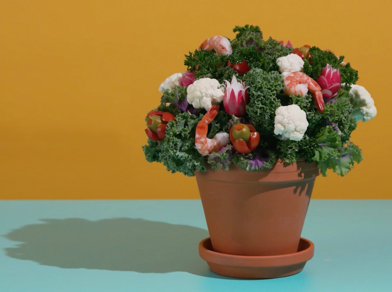 Nibble tree: A 1966 party appetizer remake of kale leaves, radish flowers, shrimp and olive-sytuffed tomatoes as a floral arrangement in a clay pot