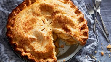 apple recipes: Apple pie with a slice cut out
