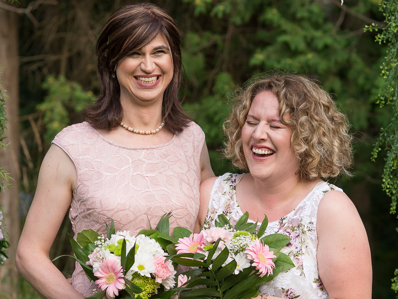 trans daughter-Zoe and Amanda pose on their wedding day.