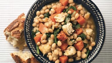 Hearty chicken stew recipe with carrots, beans and spinach
