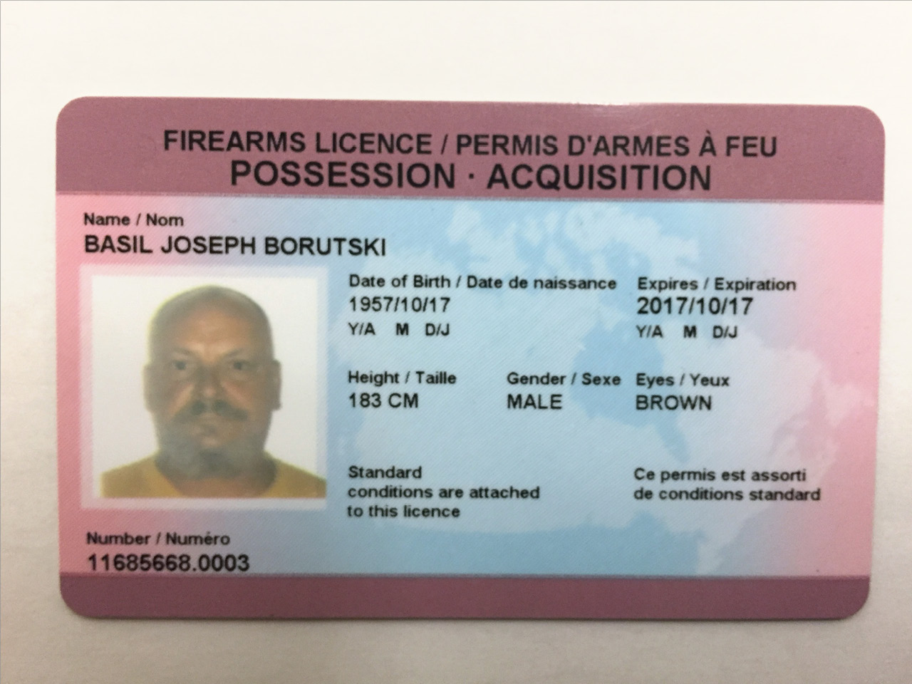 Basil Borutski was carrying a gun licence when he was arrested, even though he was under a weapons ban at the time.